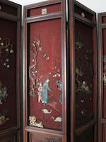 A fine eight-panel cinnabar lacquer screen with hardstone overlay 19th century
