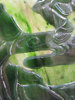 A carved 'spinach' jade table screen