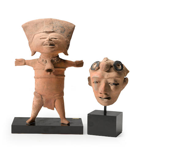 A Veracruz standing figure and fragment head