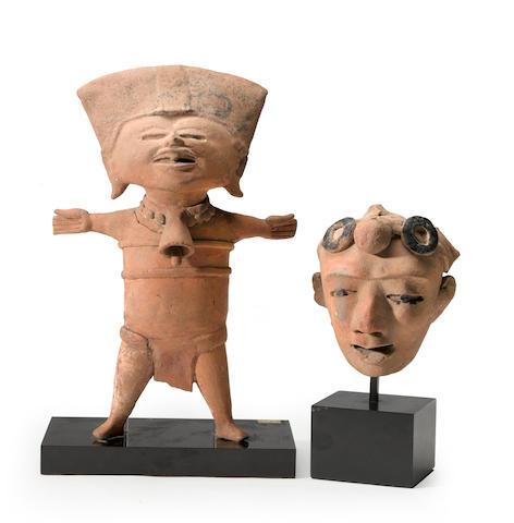 A Veracruz standing figure and fragment head