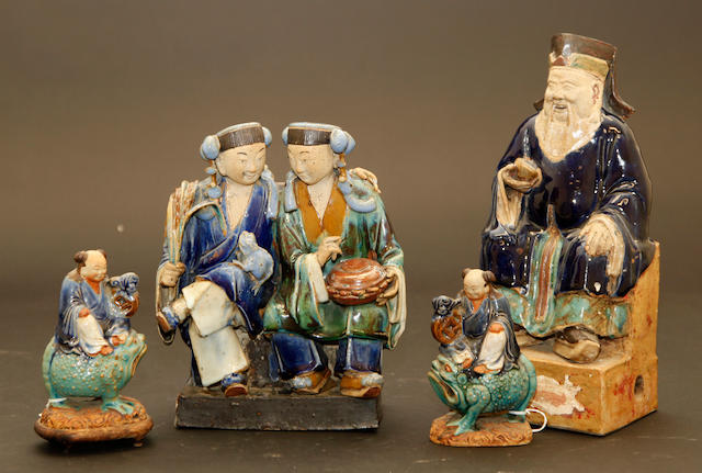 A collection of four Shiwan glazed ceramic figures late Qing dynasty
