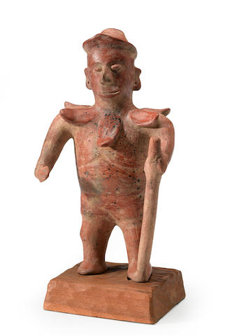 A Colima earthenware standing Shaman, Protoclassic, ca. 100 B.C. - A.D. 250