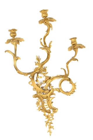 A pair of gilt bronze three light bras de lumière