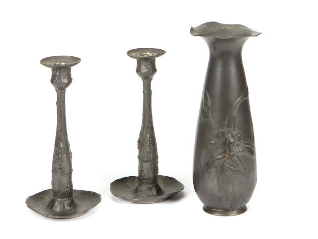 A pair of Kayserzinn Jugendstil pewter candlesticks and a vase circa 1900