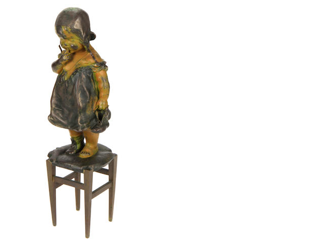 A spelter and bronze figure of a child standing on a stool cast after a model by Juan Clara, early 20th Century