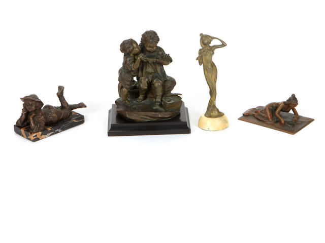A group of four patinated bronze and marble figural table ornaments late 19th and early 20th Century