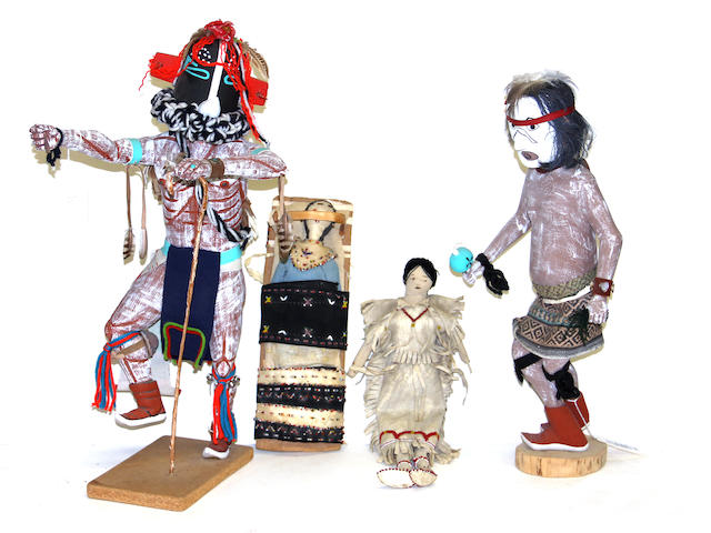 Four Native American dolls
