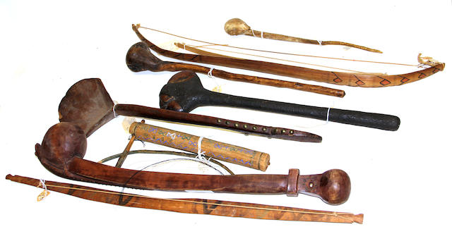 A collection of Native American wood implements