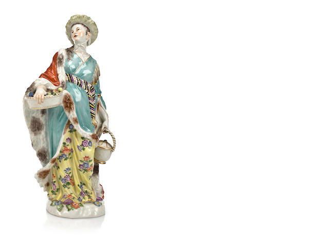 A Meissen porcelain figure of a lady with a basket