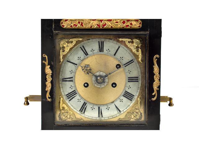 An ebony repeating bracket clock with alarm bearing the signature Joseph Knibb Londini fecit