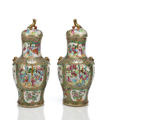 A pair of lidded porcelain vases with famille rose enamels, 19th century