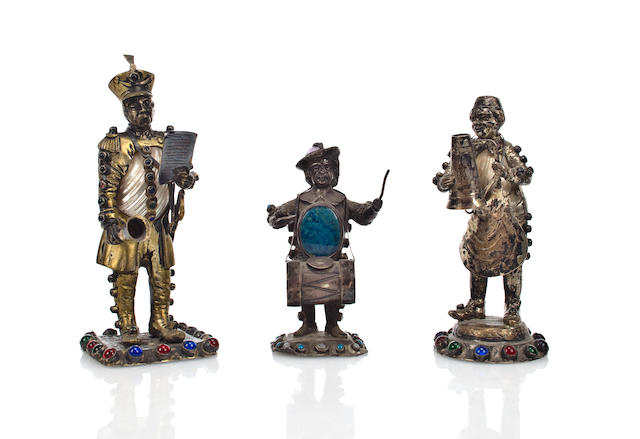 Three Austro/German silver gilt, shell or hardstone and 'jeweled' entertainment figures, mid-19th century heights: 4 3/4 in. to 6 1/2in. One shell broken with losses.