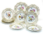 Nineteen Meissen porcelain reticulated dessert plates late 19th/early 20th century