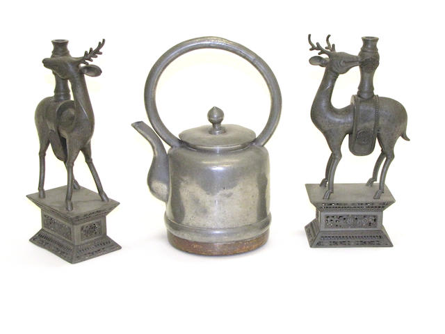 A pair of Chinese pewter candle holders