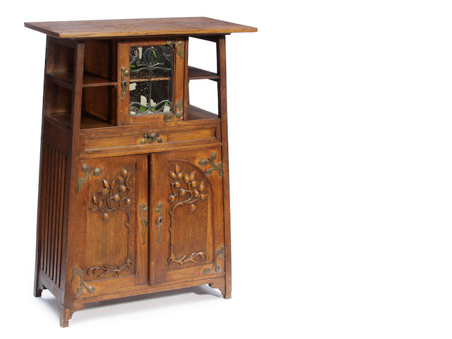 An Art Nouveau leaded-glass and oak side cabinet