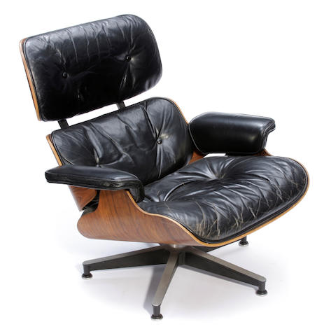 A Charles and Ray Eames for Herman Miller rosewood and black leather lounge chair Model 670