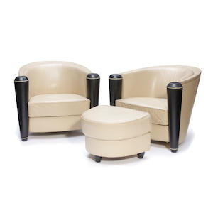 A pair of Art Nouveau style leather club chairs with ottoman