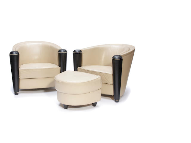 A pair of Adam Tihany for I4 Mariani leather  Marni club chairs and an ottoman