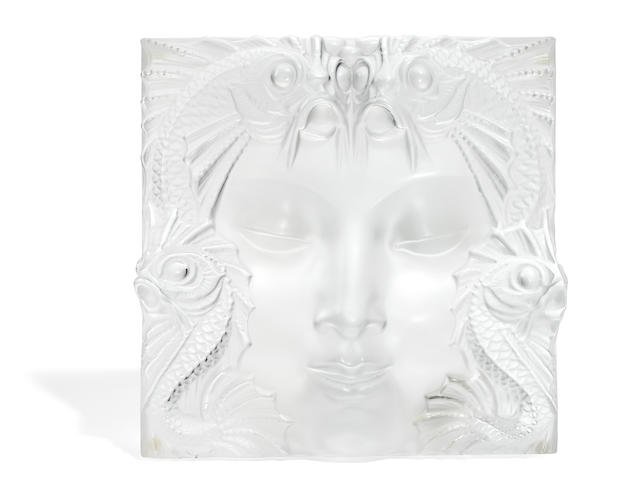 A Lalique molded glass plaque
