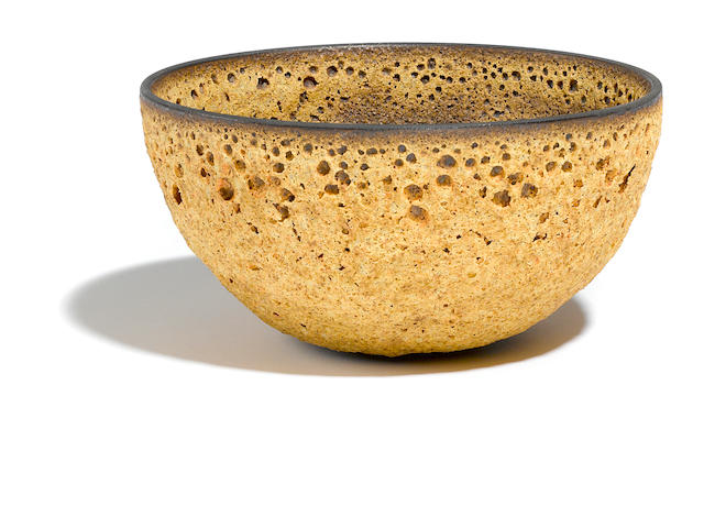 A James Lovera earth and crater glazed earthenware bowl
