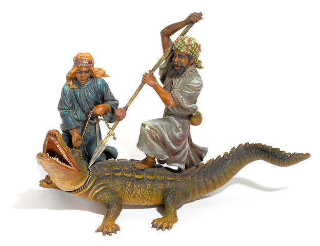 An Austrian cold painted bronze figural group of two Arabs wrangling a crocodile circa 1900