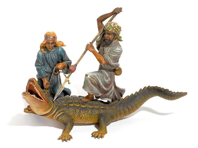 Two Arabs wrangling a Crocodile