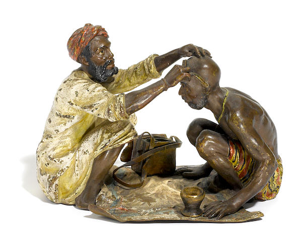A Franz Bergman cold painted bronze figural group of an Arab barber at work circa 1900