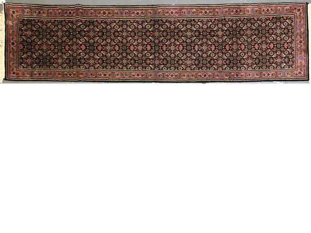 An Indian runner size approximately 2ft. 6in. x 9ft. 8in.