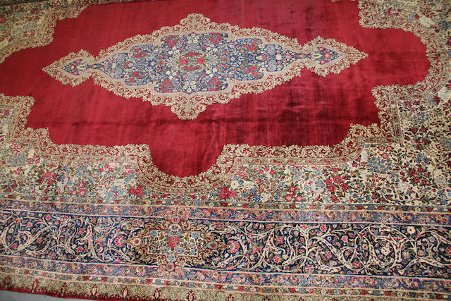 A Kerman  size approximately 13ft. 11in. x 20ft. 10in.