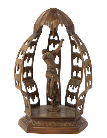 An Art Deco style patinated bronze figural sculpture