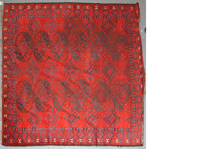 An Afghan rug  size approximately 7ft. 5in. x 8ft. 1in.