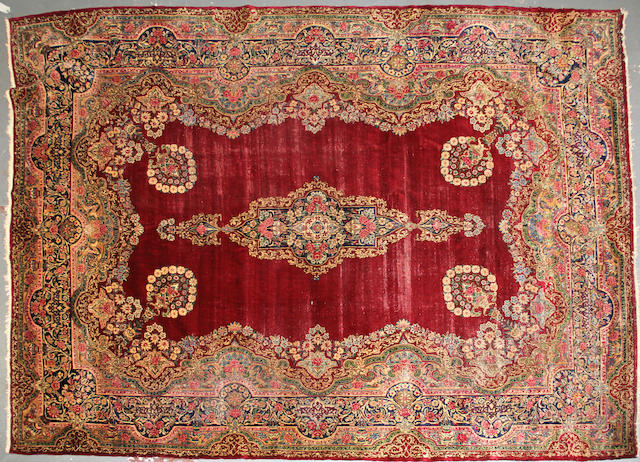 A Kerman carpet size approximately 8ft. 8in. x 12ft.