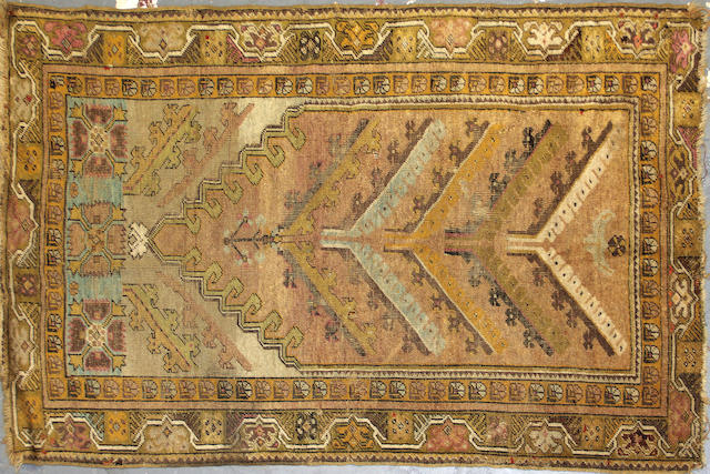 A group of three Turkish rugs