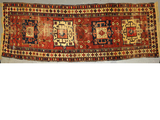 A Caucasian carpet size approximately 3ft. 8in. x 12ft. 9in.