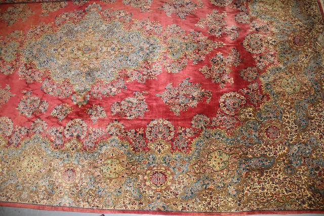 A Kerman carpet size approximately 13ft. x 19ft. 9in.