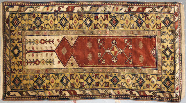A Turkish carpet size approximately 3ft. 9in. x 7ft. 1in.