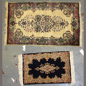 A pair of Kerman rugs