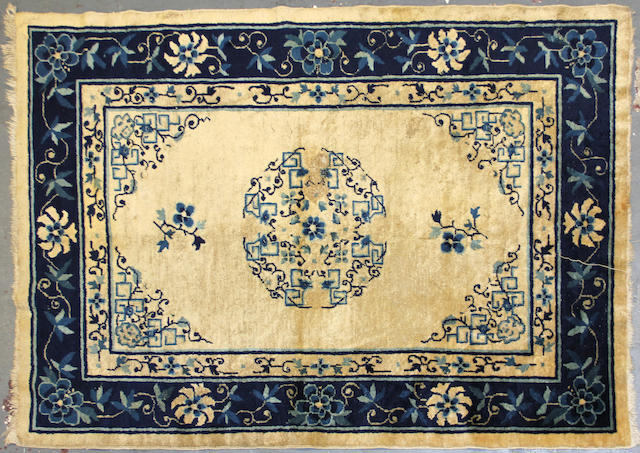A Chinse carpet size approximately 4ft. 1in. x 5ft. 9in.