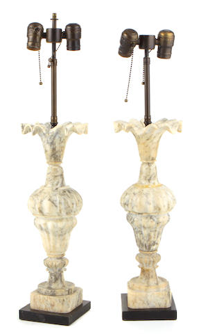 A pair of Neoclassical style alabaster urns, mounted as table lamps