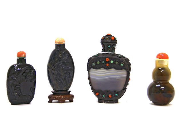 An assembled grouping of four snuff bottles