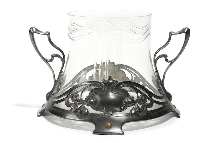 An Art Nouveau pewter and glass two-handled center bowl