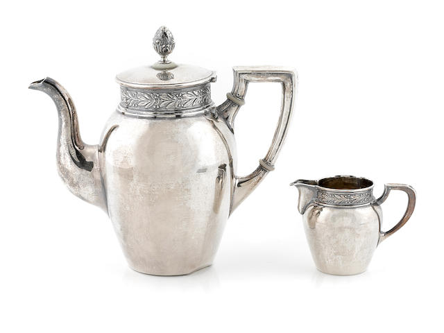 A Continental 800 standard silver teapot and cream jug