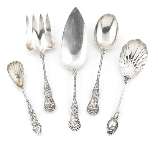 A group of Five American sterling silver flatware serving pieces, comprising four Tiffany & Co. (3 'Olympian' & 1 Atlantis [possibly later re-cast]) and one Reed & Barton 'Cameo' servng spoon