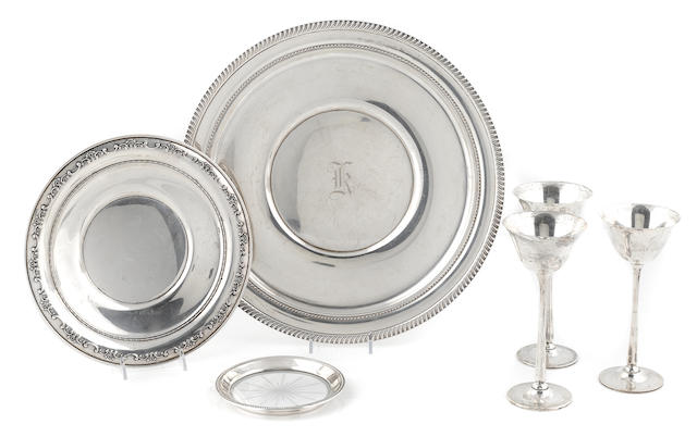 A group of American sterling silver hollowware, comprising three circular plates and seven stemmed cups, 10 pcs