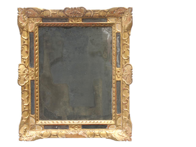 A Louis XVI style giltwood mirror with vitruvian scroll border