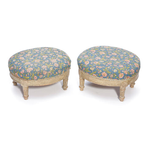 A pair of Louis XVI style paint decorated oval tabourets