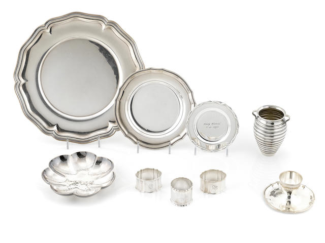A group of sterling silver table articles, comprising trays, a small scalloped bowl, napkn rings, butter dishes, an egg cup and a honey pot