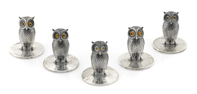 A set of eleven sterling silver owl form place card holders