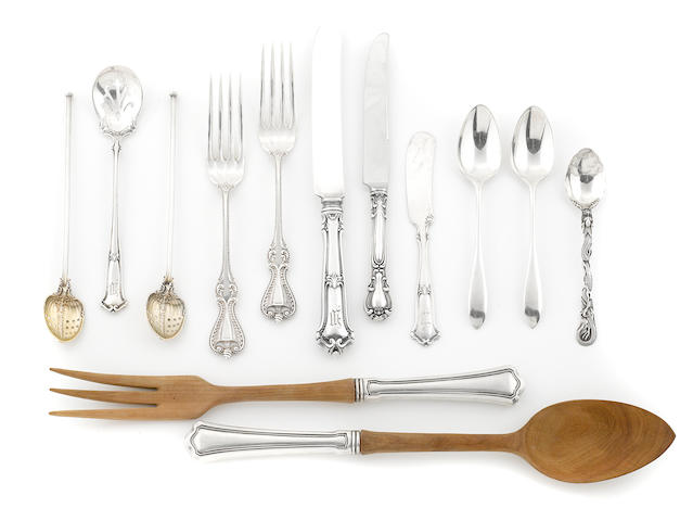An assorted group of sterling silver flatware