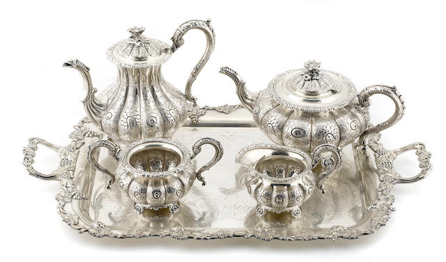 An Edward VIII sterling silver four piece tea and coffee service, Barker Brothers, Birmingham, 1949; together with a silverplate two-handled tray